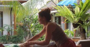 woman massaging a woman's back